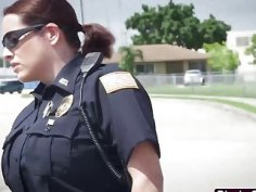 Muscled black dude fucks two slutty female cops by their car