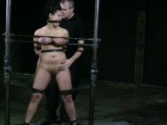 Hefty built slut Dana Vixen is locked up in a BDSM video