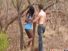 African slut blowing big white schlong outdoors