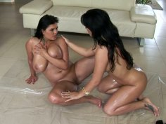 Two hottest chicks in the porn industry Jasmine Black and Amanda Black are rubbing each other's bodies with oil