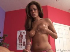 Oiled up busty babe Isis Taylor gives a blowjob in 69 style pose